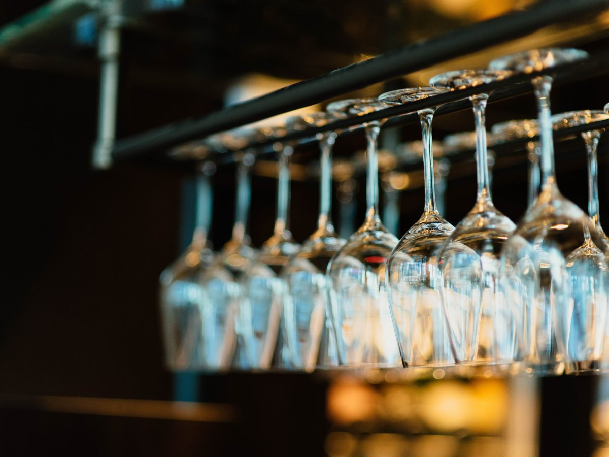 piled wine glass set hanging